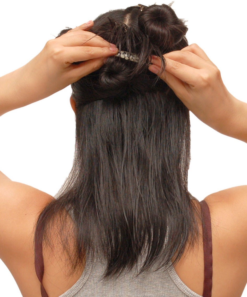 Firstly divide your hair into sections this will make it easier to cover all your hair. Now sprinkle the talcum powder over your hand (Palm side) and rub together, then start working the powder into the roots of your hair working down towards the ends. Repeat this with every section...