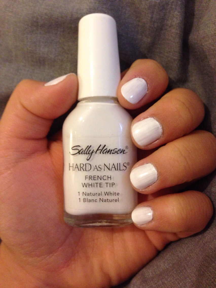 Apply a second coat of thin French tip nail polish. This helps your main white nail polish colour to apply evenly without being streaky.