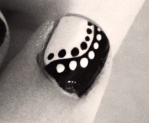 INDEX: paint 2/3 of the nail white, and the other 1/3 black. using the black brush, create a curve into the white side go along this curve with dots, making white dots on the black side and black dots on the white side