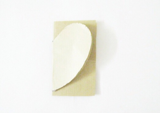 Fold the paper into half and keep the heart stencil on it and cut the heart shape.