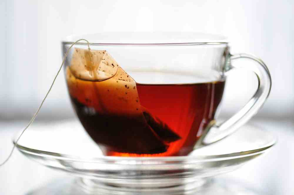 It's a total myth that drinking tea is good for singing. For 1.it caffeinated and dehydrates you and also dries your chords. 2. If it's hot, it shocks the natural temp of your body. If you choose to drink tea make it room temp decaf. If you like water make sure it's also decaf.