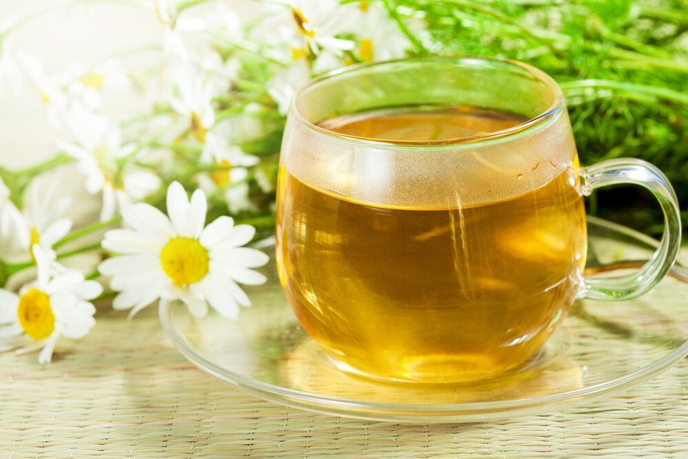 Use some chamomile tea to lighten your hair. All you do is boil the water, let the bags steep, then add to your hair. You can go out into the sun until it dries for a better effect of stay inside