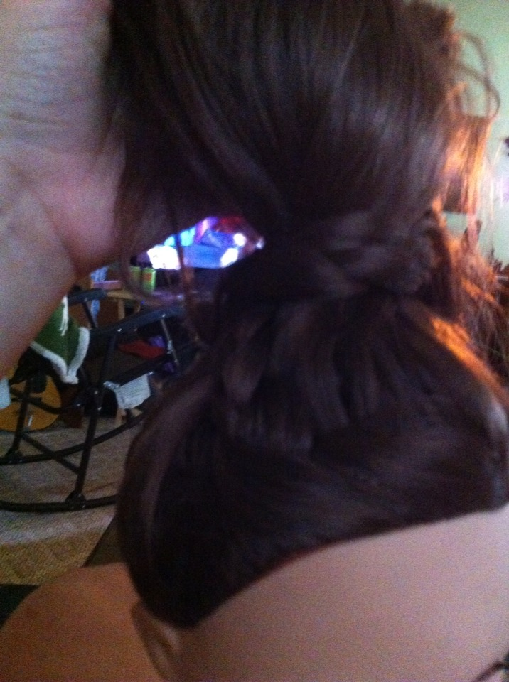 Then take the braid and wrap it at the bottom of the ponytail and pin the end with a bobby pin