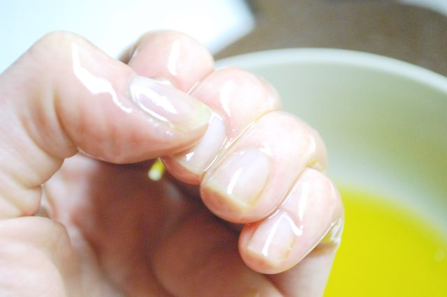 Soak your nails in olive oil for five minutes. And then sit back and admire your pretty hands.