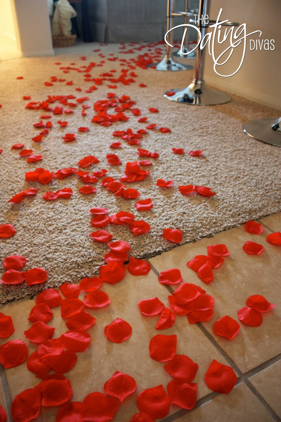Set up a trail of rose petals to the living room or somewhere with a tv. Have popcorn and maybe wine set up, insert a romantic movie and a perfect night for your woman.