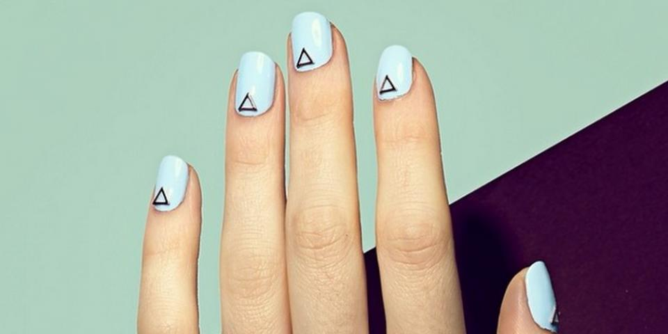"""Try L'Orèal Paris Colour Riche Nail Polish in """"Greycian Goddess,"""" $6; Essie Nail Polish in """"Romper Room,"""" $9; Morgan Taylor Nail Polish in """"Water Baby,"""" $6; Laura Mercier Nail Lacquer in """"Lavender Cloud,"""" $18; and Smith & Cult Nail Lacquer in """"Bitter Budhist,"""" $18, to get a look like this one."""