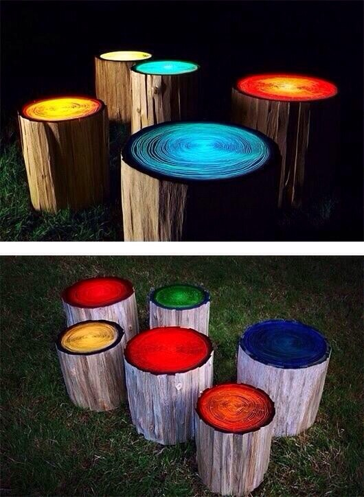 Log stools painted with glow in the dark paint.