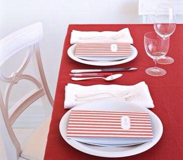 Give guests who read between the lines at your party a place to write it all down (and don't forget to place a pen amid the cutlery). The nameplate on the cover makes this brightly striped notebook (available in a variety of colors and patterns) -