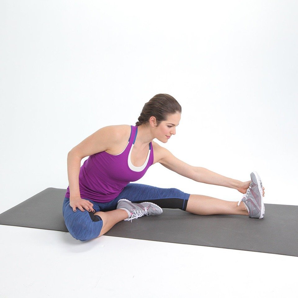 Reach down to your feet as long as you can. This will allow your hamstrings to loosen while preparing for the split.