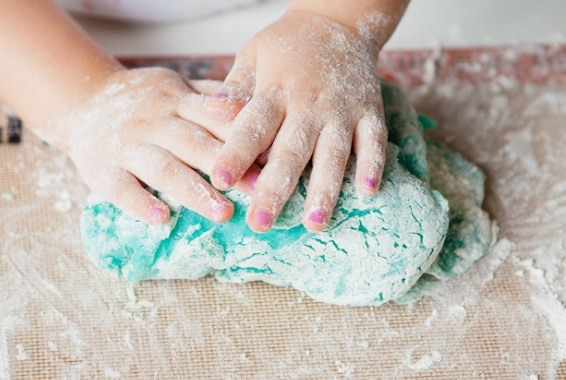 Put the warm dough on a floured cutting board.  Let it dry for 20-30 minutes.  Knead the dough and add in as much flour as it takes to get rid of any stickiness.  (You can add in extra food coloring and glitter)