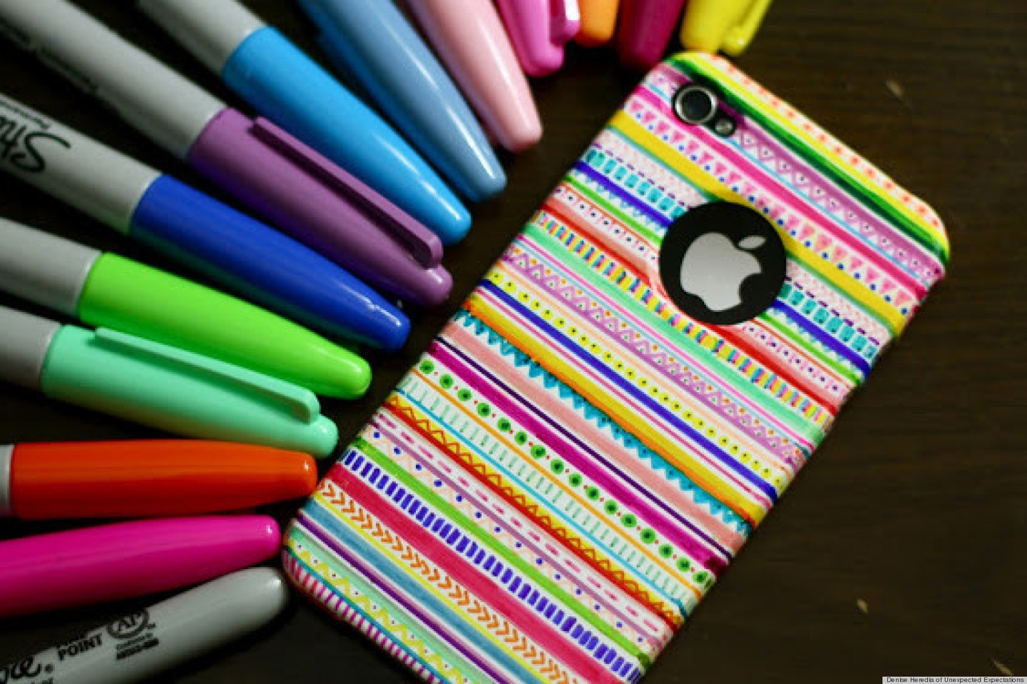 Find a design on google and draw it on your case with colored markers. Then wait for it to dry.