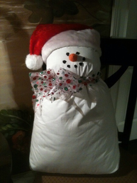 This is made from a standard bed pillow with a santa hat and a bow around the neck! Please like and share !!!