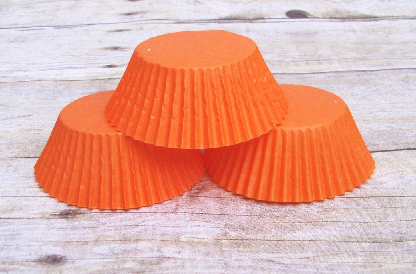 1. Get orange cupcake liners.