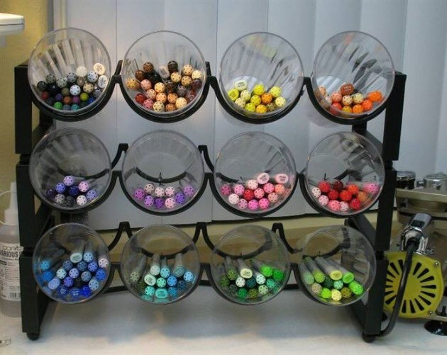 Place cups into a wine rack to sort out pens or lipsticks.