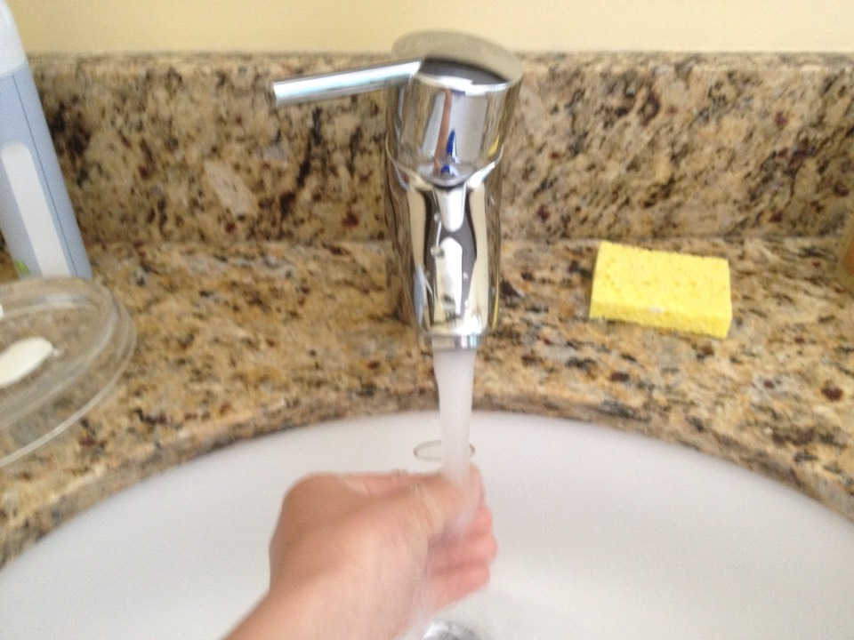 Run your hand under tap water until warm. It doest need to be hot. Just warm.