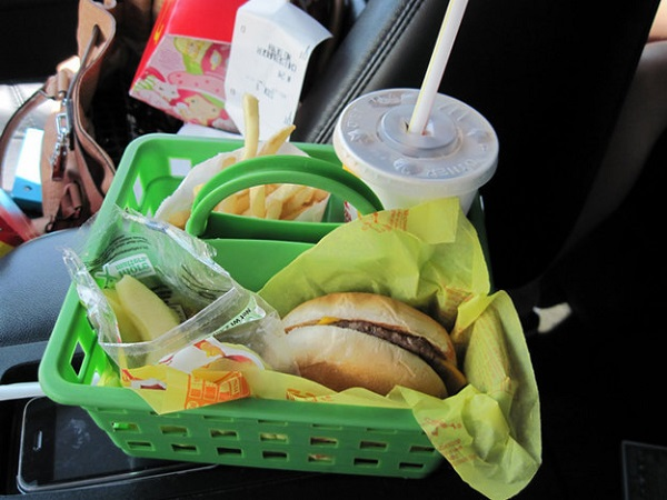 Use plastic shower caddies in the car for when you eat food.
