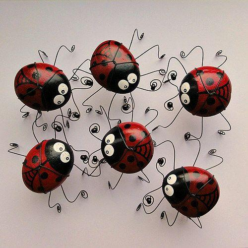Stones painted like lady bugs and strong bent wire for feet