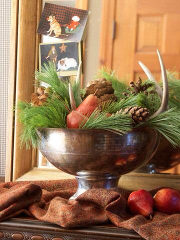 Bountiful bowl  Fresh loose greens, large pinecones and red pears give a compote a natural look. Tuck in antlers for a rustic touch.