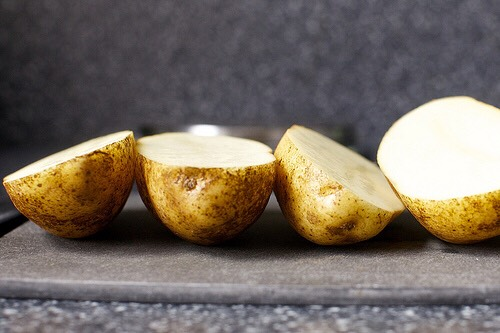 Cut potatoes in half & scoop out potato with a spoon. Leave a little bit around the edges.