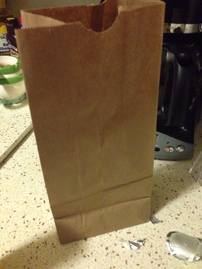 Pour about half a cup of kernels into a regular brown paper bag...
