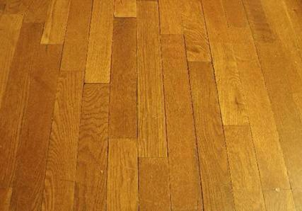 To silence your squeaky hardwood floors sprinkle some baby powder on the squeaky area and sweep it into the cracks.  Then wipe the floor. The baby powder between the boards will act as a lubricant and will stop the annoying noise.
