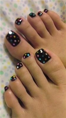 Paint your nail a base color, doesn't necessarily have to be black! Then use a dotting tool or a bobby pin to make polka dots in any colors you want! So easy! 👍👍👍