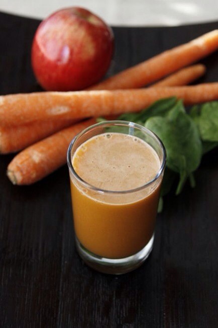 "Carrot, Apple & Spinach Juice  This is a great ""starter"" recipe for people just getting into juicing, utilizing sweet carrots and apples with just a smidge of green."