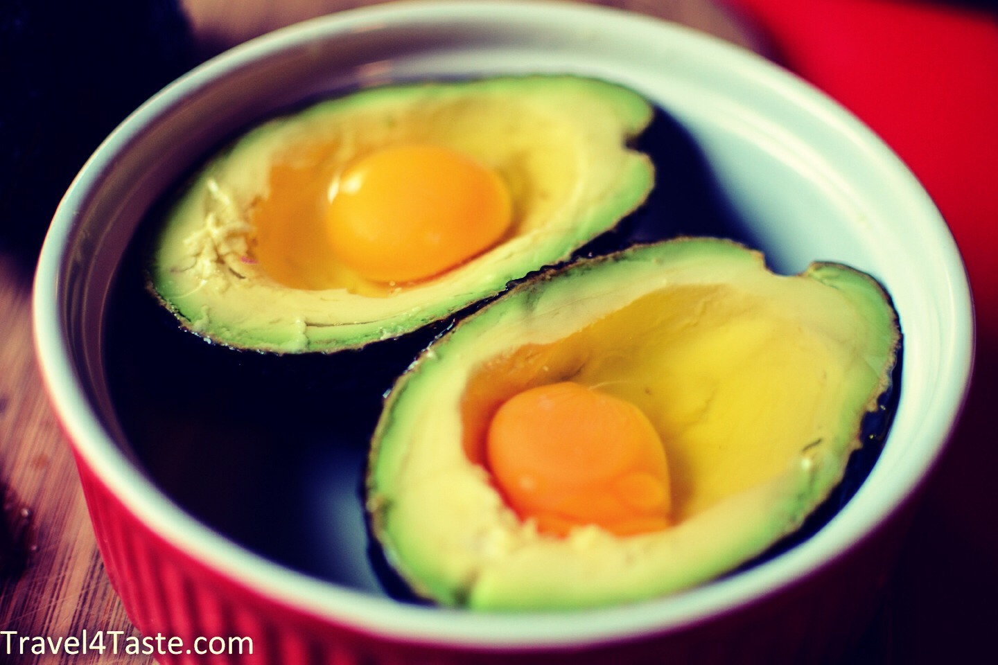 Put each egg in avocado slice and add salt and pepper for flavor
