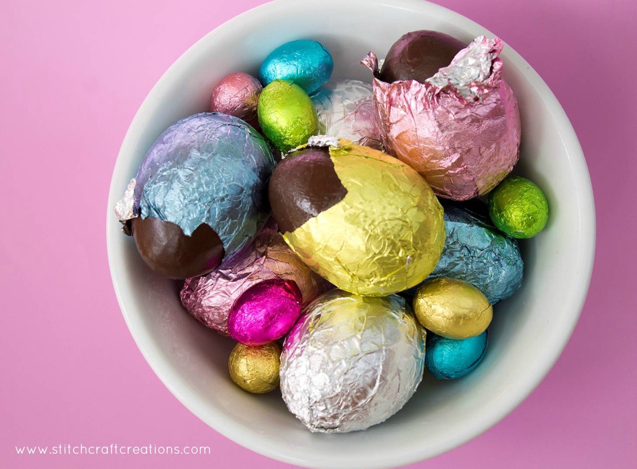 4. Carefully un-mould the egg halves and place on a clean surface. Take care not to handle the chocolate too much as it will start to melt from the heat of your hands.