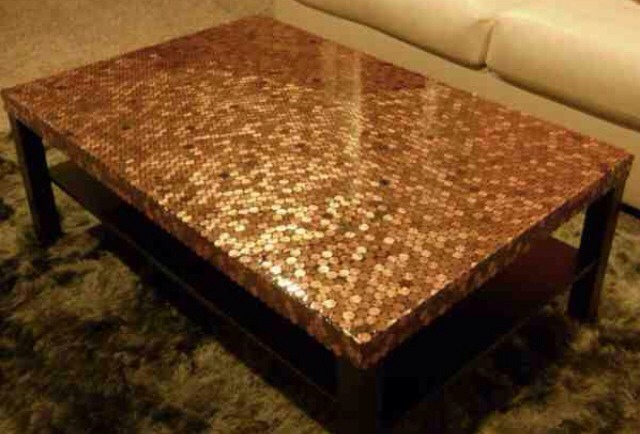 You'll need a table, lots of pennies, glue, a paint brush, pliers, glaze resin, paint sticks and a heat gun or torch. First rinse all the pennies and then start gluing them to the table. Start from a corner and work your way out.   ->