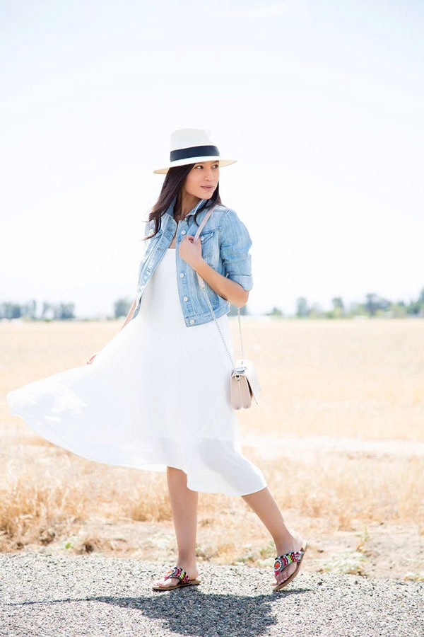 9. A white dress with a jean jacket and a hat is one of the most perfect summer outfits.