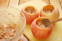 Spoon the filling back into each apple. Fill about 3/4 of the way to prevent spillage of filling while baking.