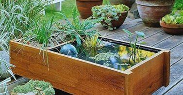 http://www.goodshomedesign.com/diy-containers-garden-pond/