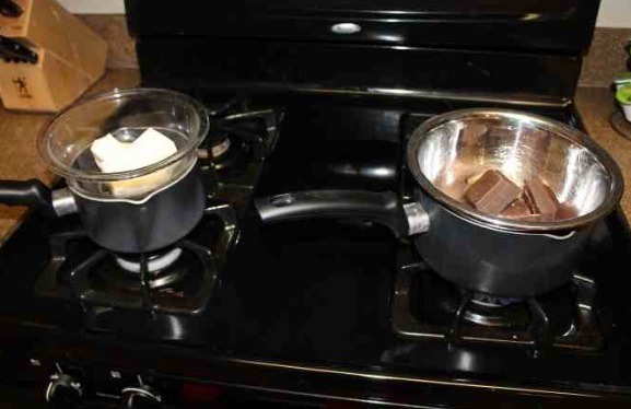 Melt the almond bark and milk chocolate