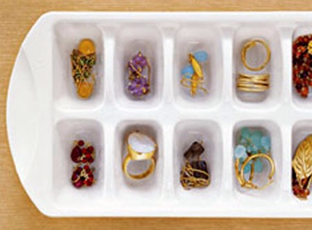 Need a way to organize all your rings and earrings without a jewelry box? Use an old ice cube try (or one that you just don't use anymore)  Paint it, decorate it, do whatever, just make it you!