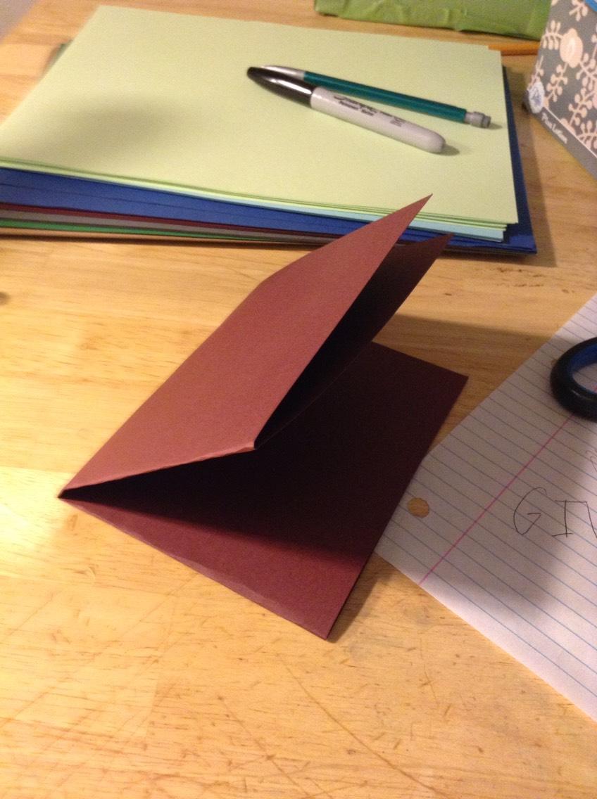 Fold the paper in half again.