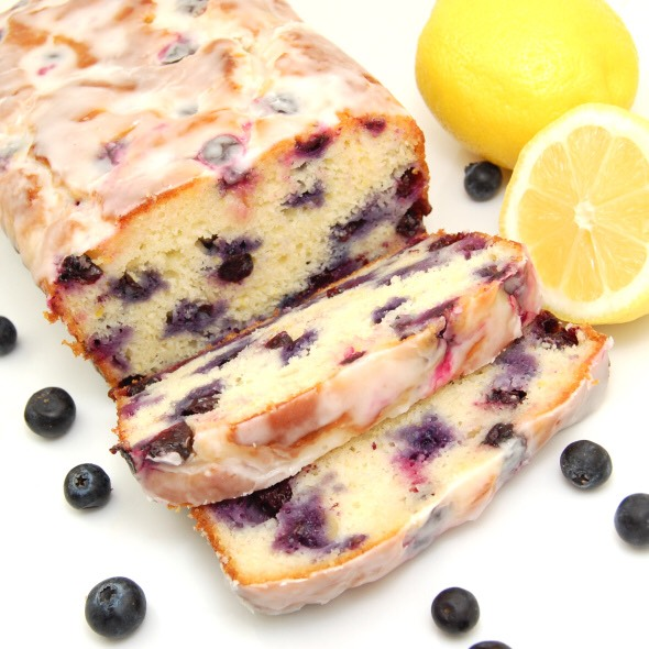 Zingy Lemon-Blueberry Yogurt Loaf made with freshly squeezed lemon juice, lemon zest, yogurt and plump blueberries is lightly brushed with a lemon syrup then drizzled with a lemon glaze. Bursting with lemony flavor and fresh blueberries, this melt in your mouth will leave you begging for more.