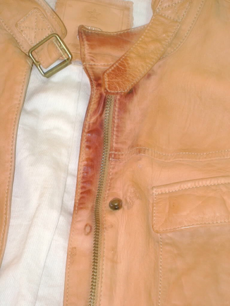 Use peanut butter to clean leather stains. You just rub some on the stain, then wipe it of with a clothe and that's it.