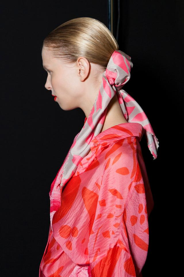 Complement a shiny, slicked-back updo by tying it off with a long rectangular patterned scarf.