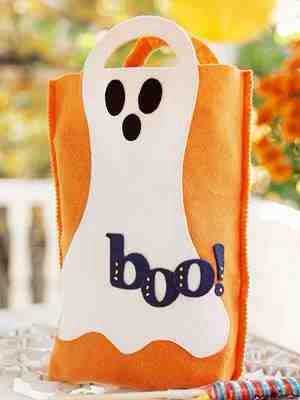 Simply sew the two pieces of felt together for the bag, then got glue ghost cut out and letters and eyes etc on bag!