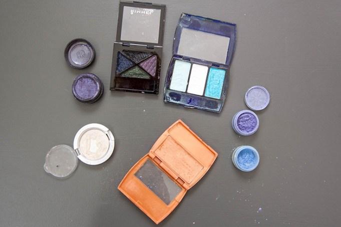 The makeup I used: light white/gold glittery eyeshadow, loose powdered bright blue eyeshadow, loose powdered bright purple eyeshadow, bronzer, shimmery black, dark blue, dark green, and dark purple eyeshadow palette, shimmery teal green palette.