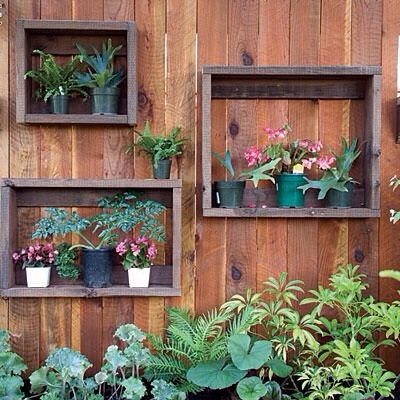 Photo frames.   These attach really easy to the fence.