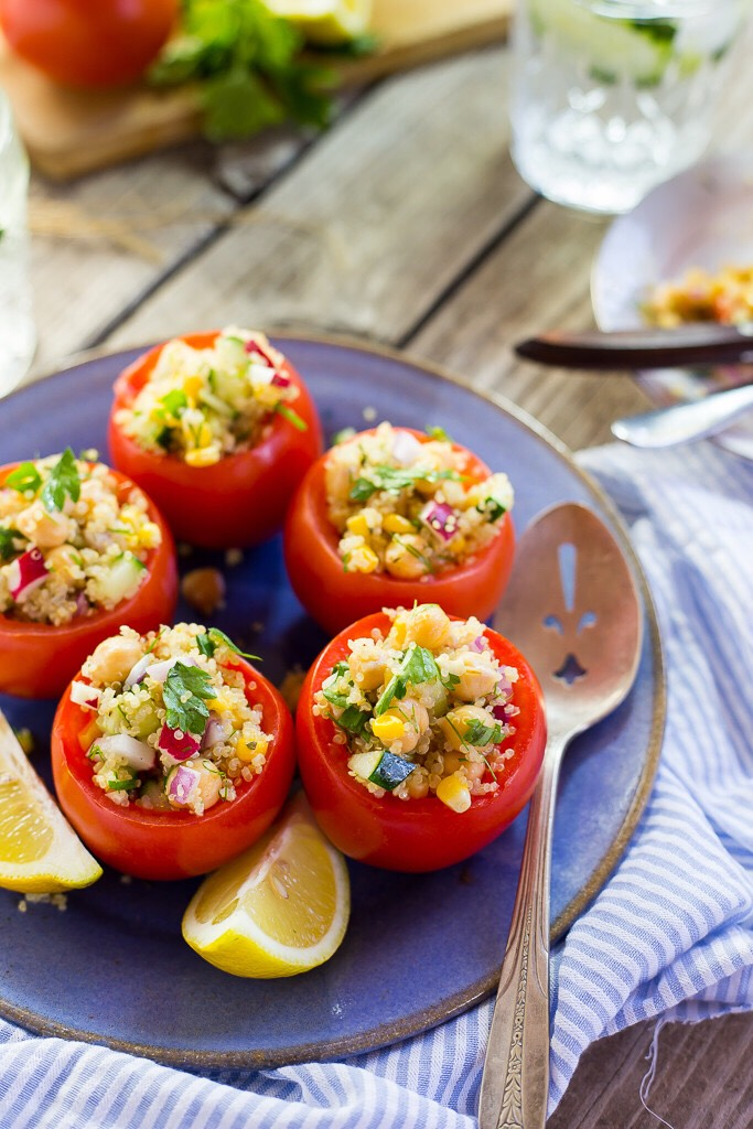 Follow this recipe for quinoa and chickpea stuffed tomatoes!