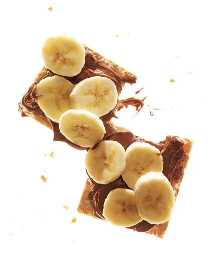 Crackers With Chocolate-Hazelnut Spread and Banana Dividing evenly, spread 2 crisp bread crackers with 1 tablespoon chocolate-hazelnut spread. Top with 1 sliced small banana.  214 calories | 6 g fiber | 4 g protein | 7 g fat