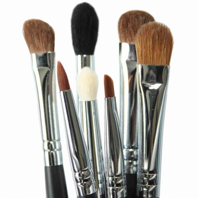 Before you apply makeup, use a paper towel and dampen it with water and rubbing alcohol. Then swirl your brushes on it until no makeup is coming out of the brush. The alcohol will kill germs on the brush that could cause you to have allergic reactions or break you out.