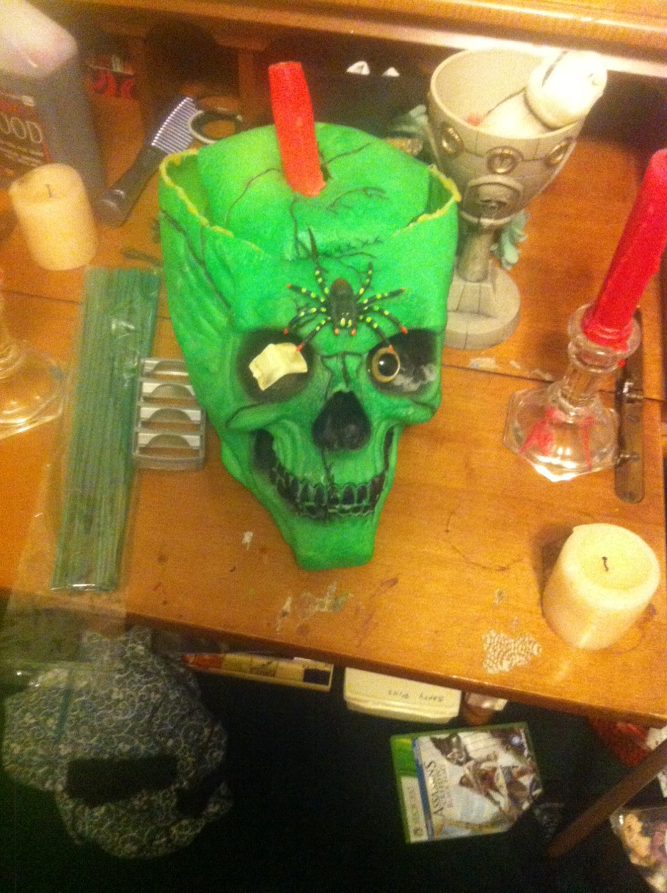 Halloween decor is a best bet. This is Steve, my skull that resides in my room. I took a simple Halloween decoration and turned him into a change/candle holder. Just by cutting out a little stuffing :)
