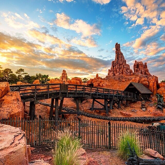 """Big Thunder Mountain Railroad Board """"the wildest ride in the wilderness"""" for a high speed train ride with twists, turns and small drops  Height: 40in or taller FP+: Yes"""