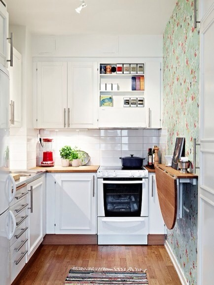 Make a Tiny Kitchen Luxurious  A tiny kitchen can be functional and even luxurious, add a folding table for added space.