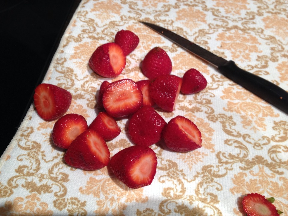 step one: wash and cut the tops off strawberries. then, dry