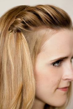 Take your bangs and twist until you want to stop. Then pull that into a ponytail and presto!